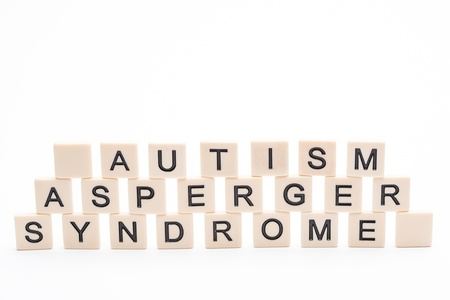 asperger syndrome: Autism asperger syndrome spelled out in plastic letter pieces on white background Stock Photo