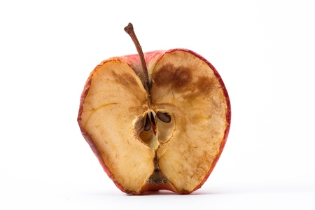 rotten fruit: Half a rotten apple on white background