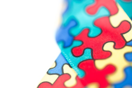 Close up of awareness ribbon for autism with copy space photo