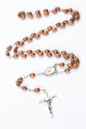 brethren: Wooden and silver rosary beads on white background