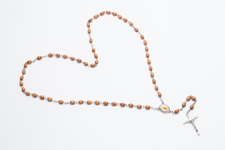 brethren: Rosary beads in a heart shape on white background Stock Photo