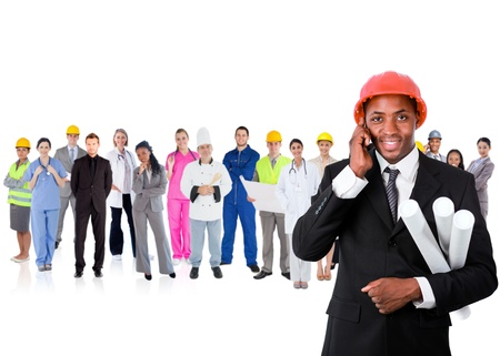 Architect on the phone in front of large diverse career group on white background photo