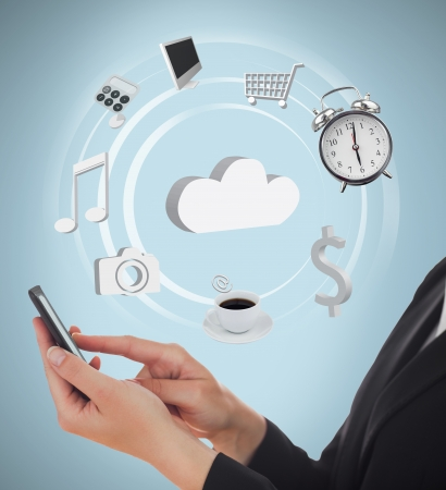 Businesswoman using applications on mobile phone and cloud computing on blue background photo
