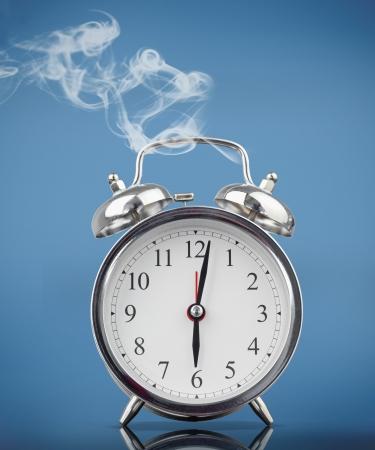 smoke alarm: Smoking alarm clock on blue background