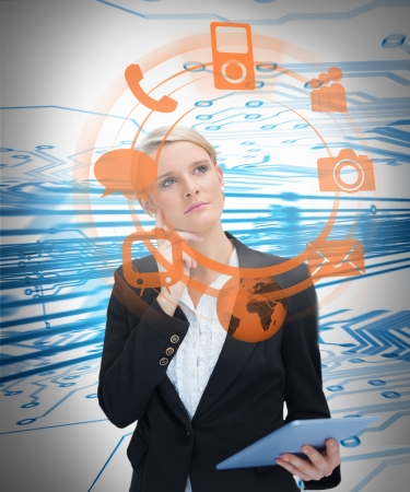 deciding: Businesswoman considering various applications and holding tablet on blue and white circuit board background