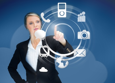 Businesswoman using wheel application interface on blue background photo