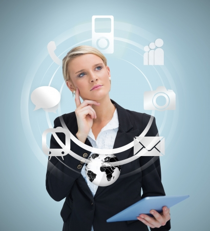 considering: Thoughtful businesswoman with tablet pc considering applications on blue background