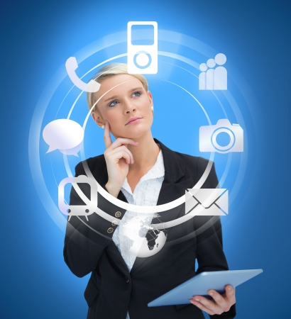 considering: Businesswoman with tablet pc considering various applications on bright blue background