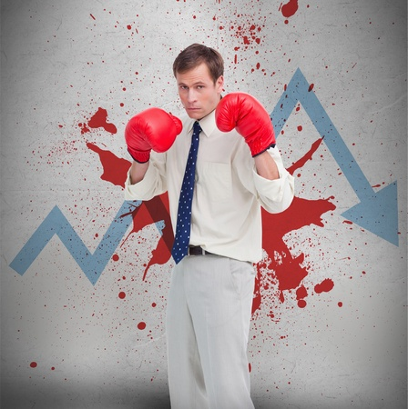 Businessman in boxing gloves against blue loss arrow and blood spatter on a wall photo