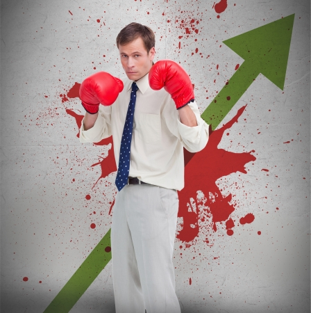 Businessman in boxing gloves against green profit arrow and blood spatter on wall photo