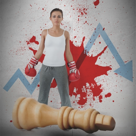 Female boxer against blue loss arrow and blood spatter with fallen white chess piece photo