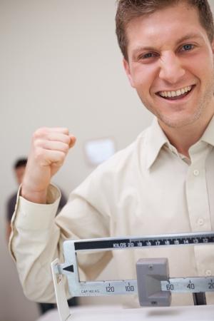 Man raising fist to celebrate weight loss photo