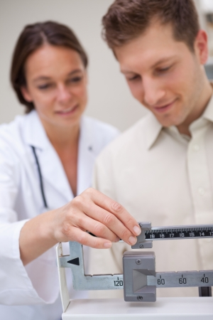 weighing: Medical scale getting adjusted by doctor