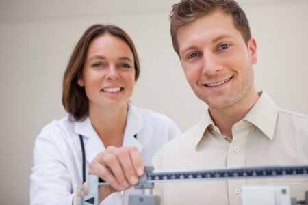 adjusted: Patient getting scale adjusted by doctor