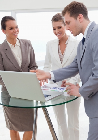 new strategy: Marketing manager presenting his new strategy to his colleagues Stock Photo