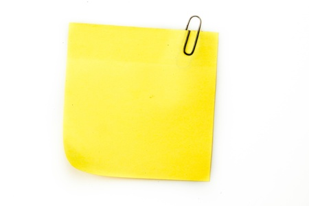 jot: Sticky note with grey paperclip against a white background Stock Photo