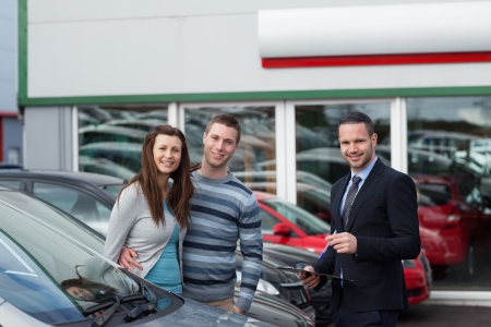Customers buying a car in a dealership Stock Photo - 18679887