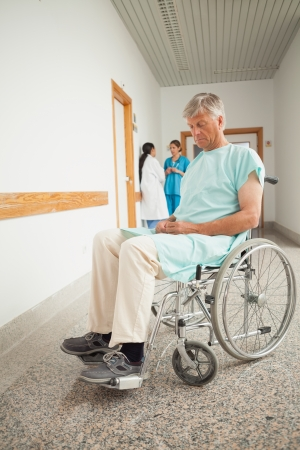 Patient in a wheelchair closing eyes in hospital Stock Photo - 18680216