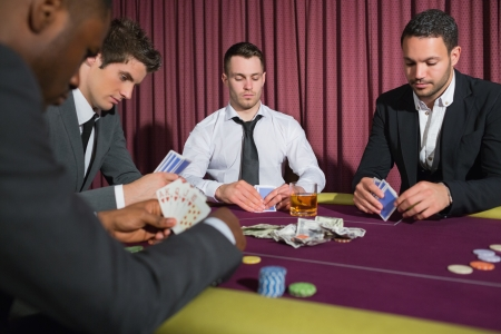 Men playing high stakes poker game in casino Stock Photo - 18466101