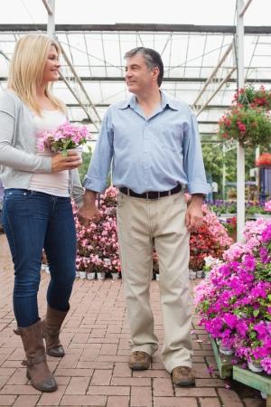 Couple walking holding hands through the garden center photo