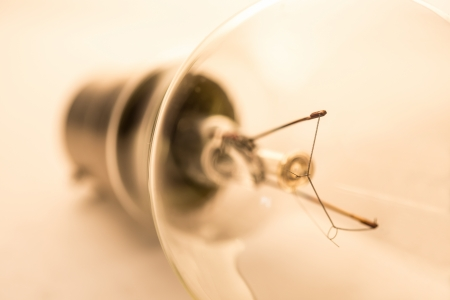 light bulb: Clear light bulb on white surface laying on its side