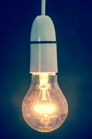 filament: Close up of dazzling light bulb in retro style