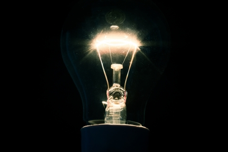 dazzling: Dazzling filament bulb on background
