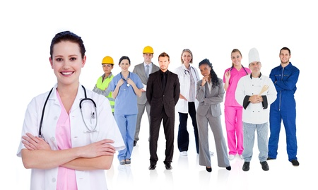 Smiling doctor in front of a team of different workers on white background Stock Photo
