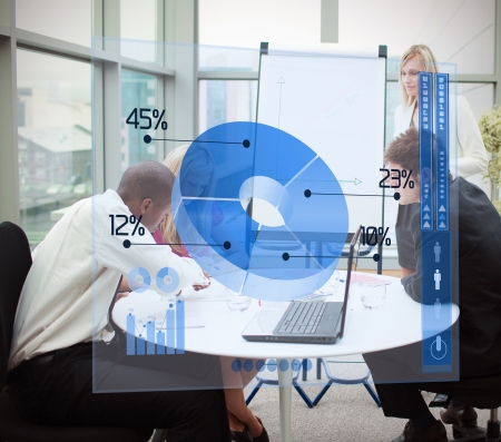Business people using blue pie chart interface in a meeting photo