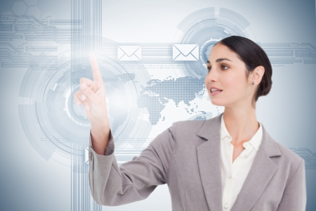 fingertip: Businesswoman using futuristic interface with her fingertip