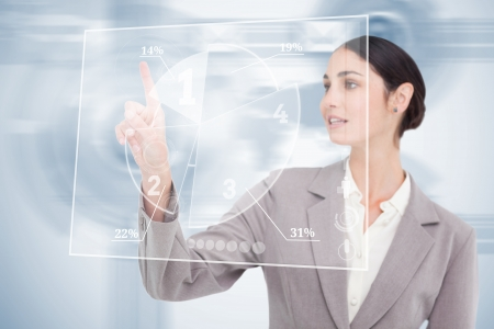 fingertip: Businesswoman using nice transparent futuristic interface  with her fingertip Stock Photo
