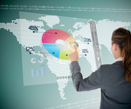 touch screen interface: Businesswoman using colorful transparent futuristic interface with map on the background