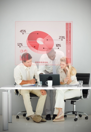 Three business people using red pie chart interface while working photo