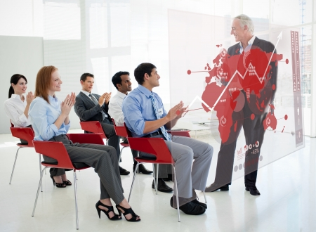 stakeholder: Business people clapping stakeholder standing in front of red map diagram interface in a meeting