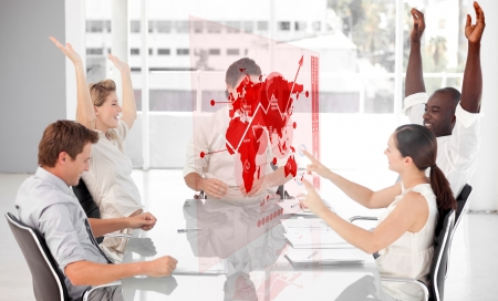 Cheerful business workers using red map diagram interface in a meeting photo