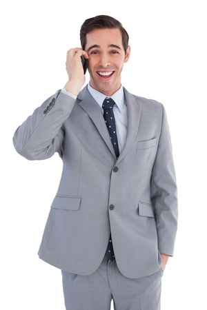 Happy businessman on the phone close up on white background photo