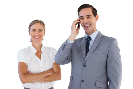 Smiling businessman on the phone next to his colleague on white background photo
