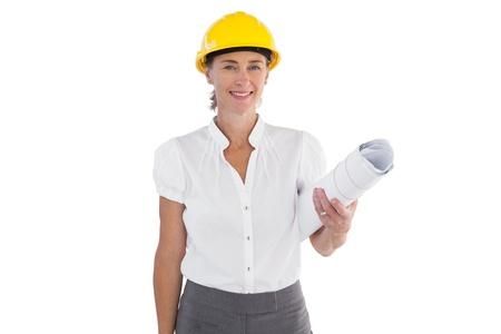 Female architect holding plans and hard hat on white background photo