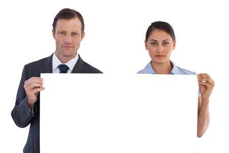 Serious co workers holding a blank copy space on white background photo