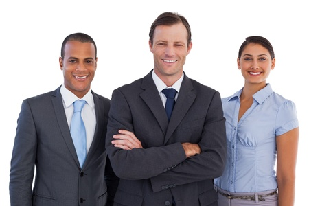 Group of smiling business people standing together on white background photo