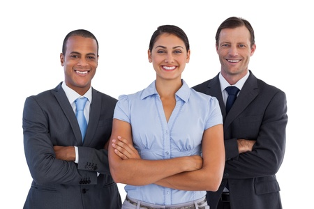 Small group of smiling business people standing together on white background  photo