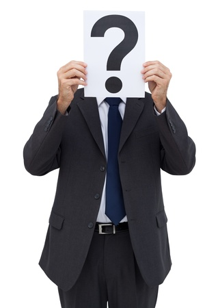 Businessman holding a question mark paper in front of his face on white background photo