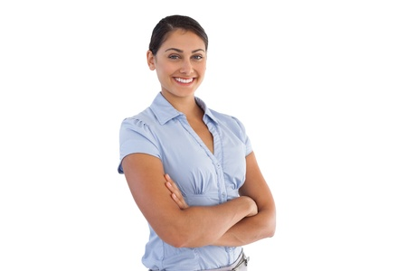 Smiling businesswoman crossing her arms on white background