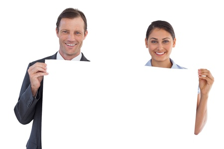 Co workers holding a blank copy space on white background photo
