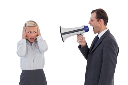 Businessman shouting at colleague with his bullhorn on white background photo
