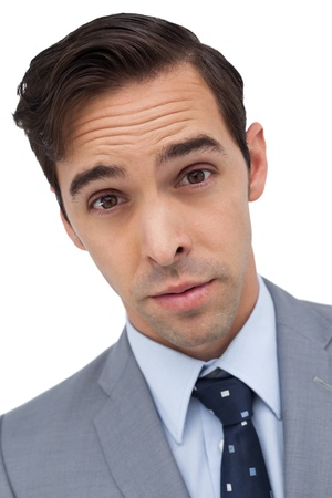 raised eyebrows: Portrait of  surprised businessman against white background Stock Photo