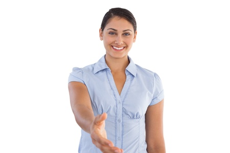 outstretching: Smiling businesswoman outstretching her hand on white background Stock Photo