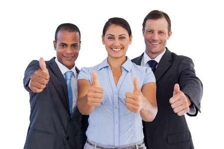 Group of smiling business people showing their thumbs up on white background photo