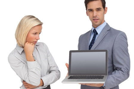Businesswoman looking at colleagues laptop on white background photo