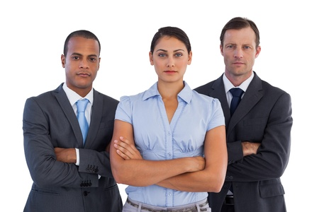 Group of serious business people standing together on white background photo
